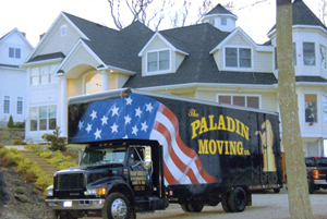 Photo of a Paladin truck at a large suburban home. Paladin Moving Company moves people into and out of homes of all sizes.